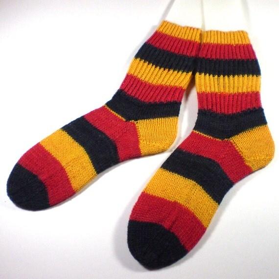 Hand knit adult socks -- Foot hugs in German national colors -- Regia World Ball wool blend yarn -- Germany socks