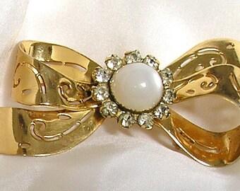 Vintage Retro Brooch Ribbon Goldtone filigree with clear Rhinestones,  imitation moonstone or pearl cabochon