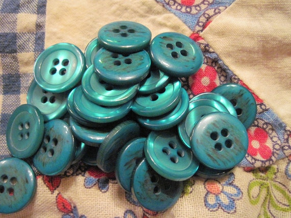 30 shimmery turquoise-teal buttons