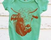 Organic desert green onesie with rust orange cow 3-6 Months