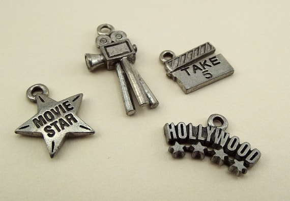 Four movie themed charms