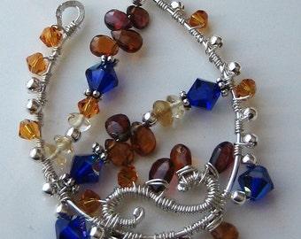 Victoria Wirework Pendant Necklace - Made of Hessonite garnet briolettes and Swarovski Royal blue AB crystals