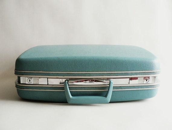 Turquoise Samsonite Silhouette Suitcase
