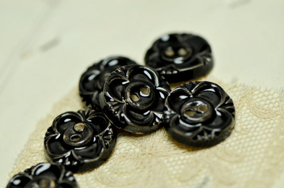 6 black .sew on buttons
