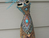 tall standing gourd dancer in Turquoise