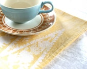 just one. butter yellow dinner napkin