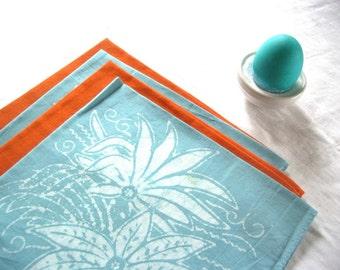 orange and blue, and turquoise napkin set