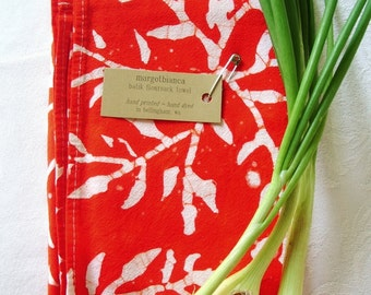 saturated red tea towel