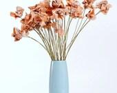 a dozen old romance novel paper flowers