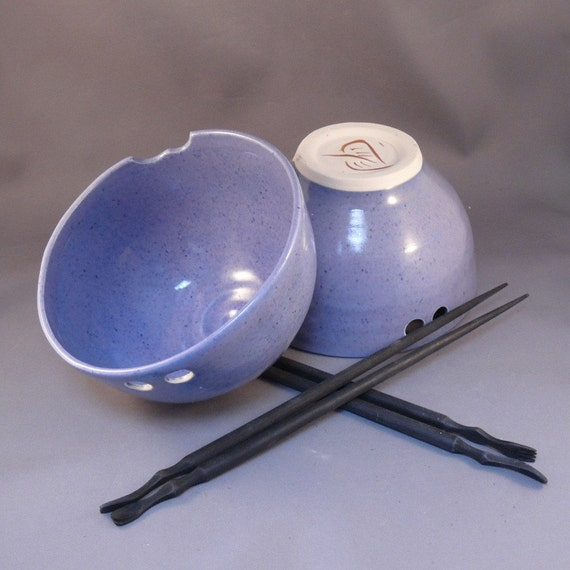 Two periwinkle rice bowls with chopsticks