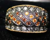 Rich-looking Joan Rivers cocktail ring w/smoky and topaz rhinestones