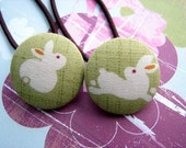 bunnies are inviting you to join their carrot cake party  - 2 ponytail holders