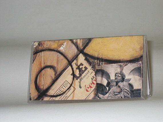 Checkbook cover, Statue