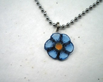 Blue flower pendant on ball chain