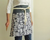 Kitchen goods on charcoal gray reversible half apron