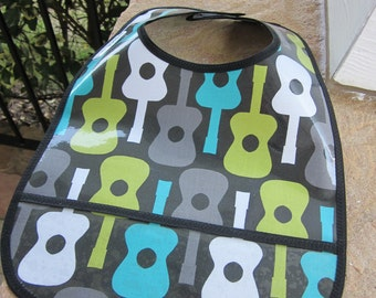 WATERPROOF WIPEABLE Baby to Toddler Plastic Coated Bib Groovy Guitars in Blue, Green and Gray