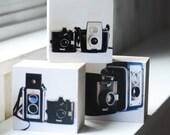 Vintage Cameras- Three sculptural photoblocks, a tryptic