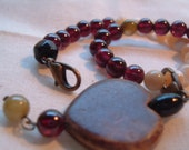garnet and shell fertility tracking bracelet