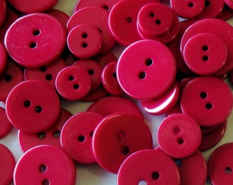 glossy red pomegranate buttons . 90 pieces