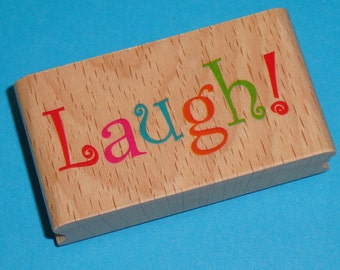 rubber stamp  / LAUGH . wood mounted
