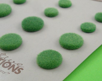 green mossy pebble brads . flocked paper fasteners