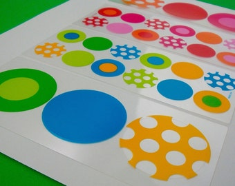 round box seals . big label stickers . clear colorful assorted brights