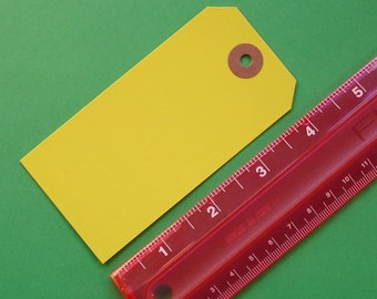 yellow shipping tags , size 4 . 75 pieces