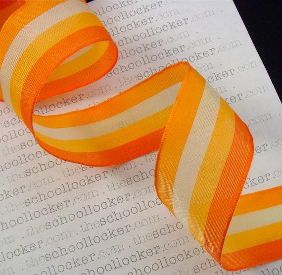 candy corn . orange stripe wired fancy ribbon . semi-sheer stripe with metallic edge . 8 yds . 1 1/2 inch . SALE