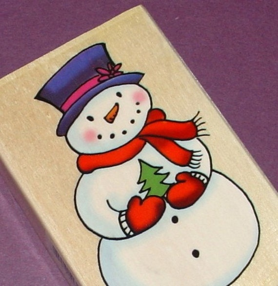 rubber mounted stamp / snowman holding tree . LAST one in stock