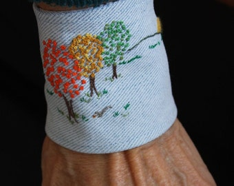 mamothreads environments embroidered denim cuff - autumn trees and squirrel