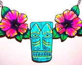 large green tiki and hibiscus flower necklace
