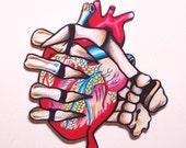 grasp my heart skeleton heart necklace