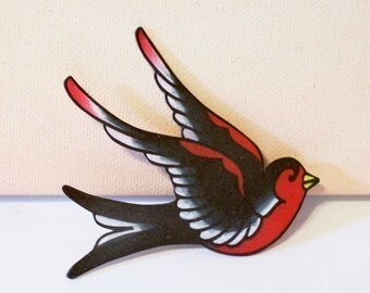 simple red and black sparrow pin