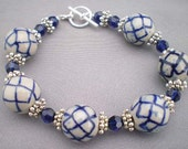 White with Blue Crosshatching Ceramic Bead Bracelet with Swarovski Deep Blue Crystals