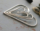 Kardia textured graduated hearts.Sterling silver or 14k gold filled artisan handmade jewelry components. Great for pendants. AGB