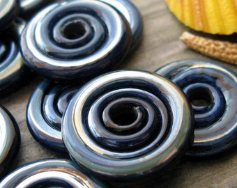 Disc beads.  Boro glass lampwork artisan handmade. Oil slick on dark plum. AGB Painting Shadows. Ready to ship.