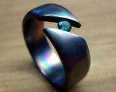 Titanium Wedding Ring- Diagonal Tension Set with Green Stone