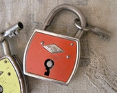 Vintage padlock with key, red-orange retro decor