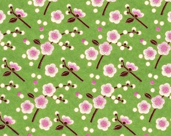 Chiyogami or yuzen paper - white cherry blossoms with pink accents on green, 9x12 inches