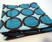 four coasters - teal circles