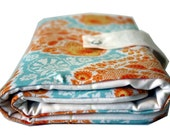 circular knitting needle organizer - orange blue paisley