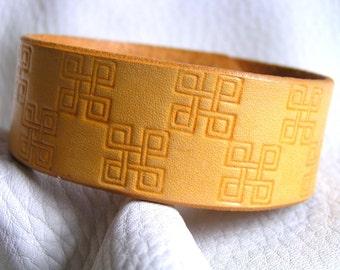 Yellow square interlace cuff
