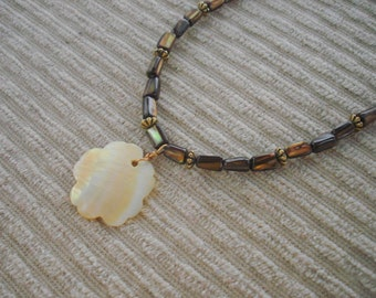 Island Dreams lip shell beaded necklace with flower shell pendant