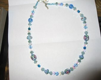 Beaded Necklace in Baby Blue, Clear, and Pink Beads.