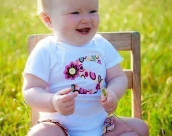 Boutique custom msde ruffle legged one piece body suit. Baby shower gift