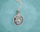 The Navigator compass necklace