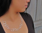 Grecian Necklace - A Collar Skimming Necklace in White Metal and Silver