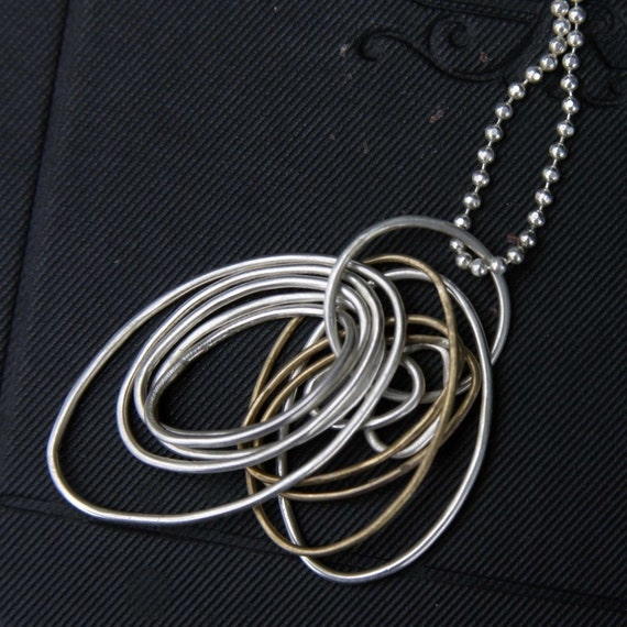 ON SALE Thousand Wishes Necklace - Silver and Gold Filled Multi- Hoop Pendant