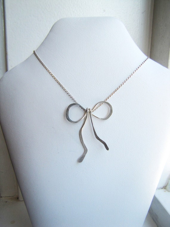 ribbon bow . sterling silver . pendant . necklace