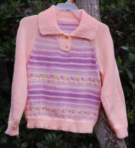 Girl, size 8, Peach/mauve striped sweater.
